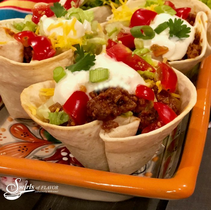 tortillas folded into cups and wrapped around taco fillings