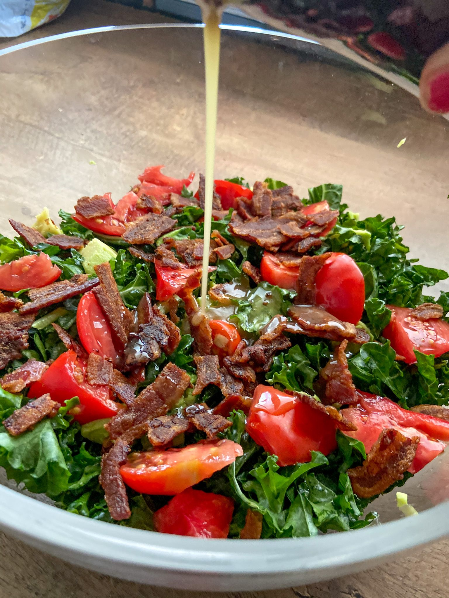 Kale Salad with a Maple Bacon Dressing drizzled on top   Fourganic Sisters