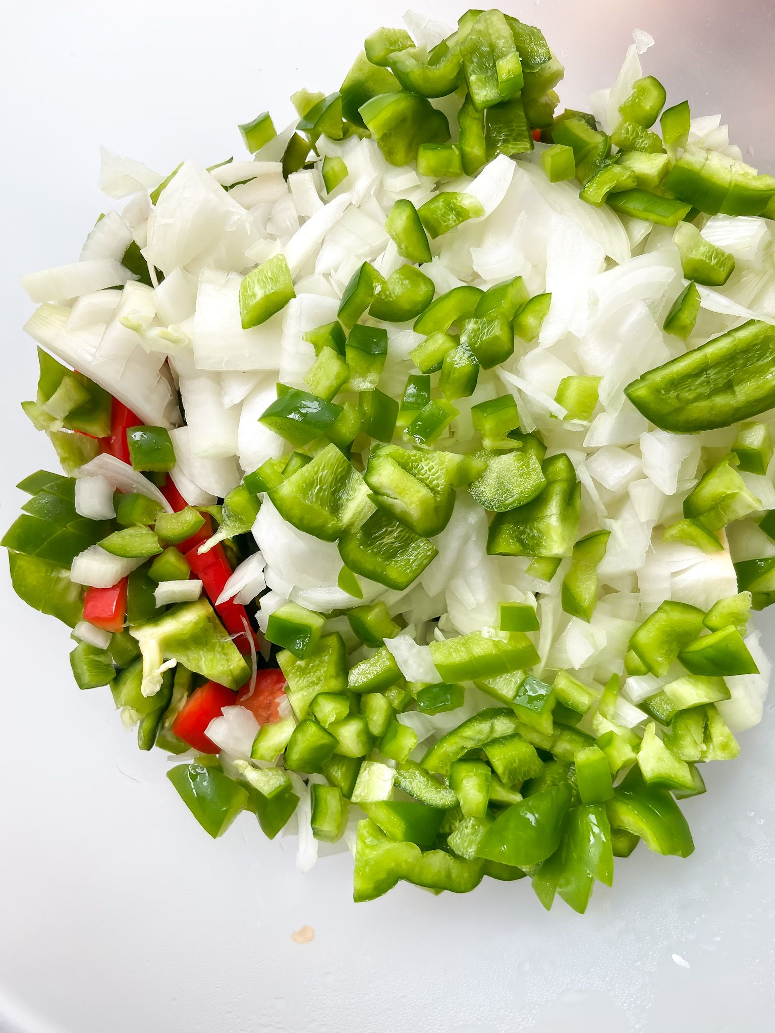 cut up peppers and onions for easy freezer meal soup starters