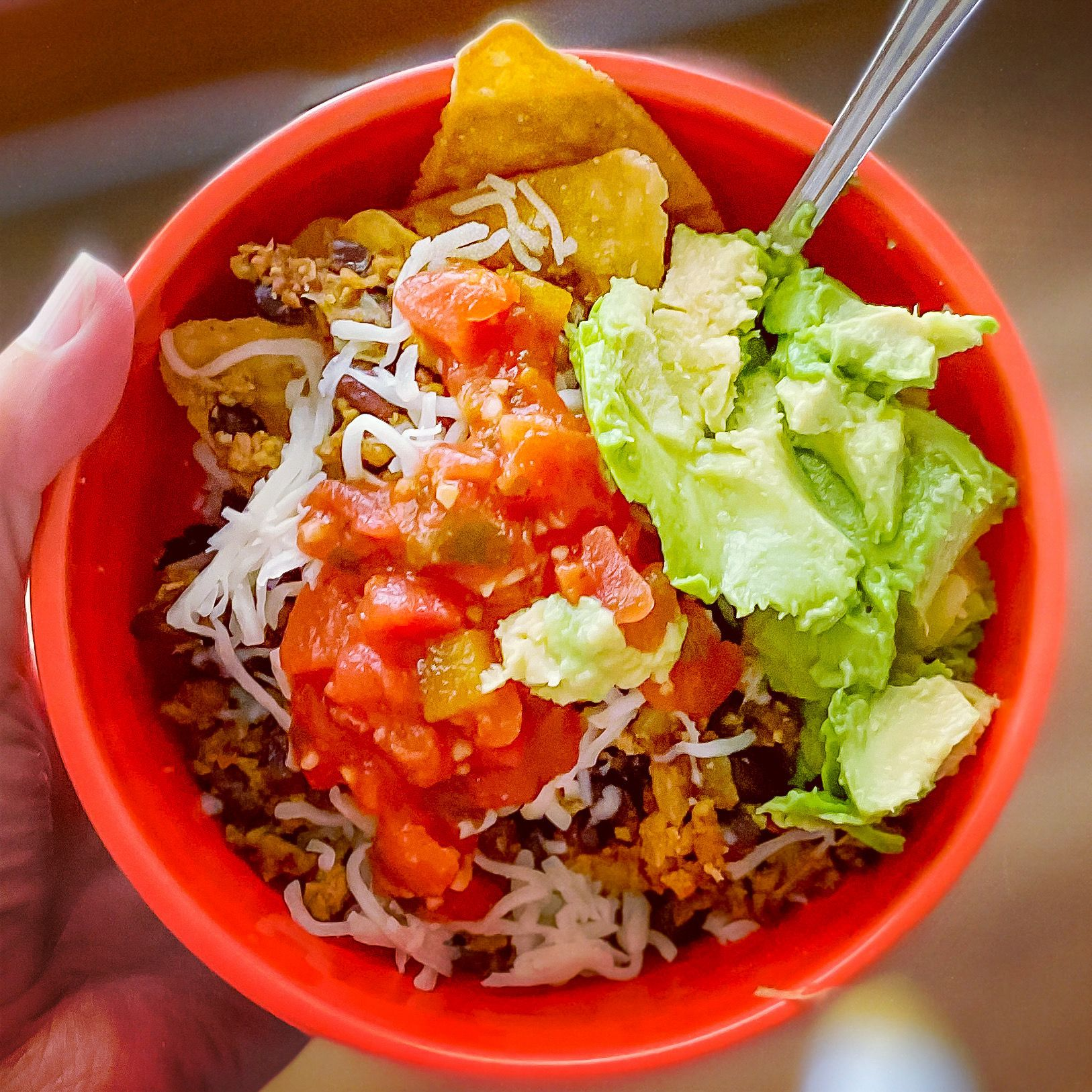 Taco Bowl topped with salsa and avocado