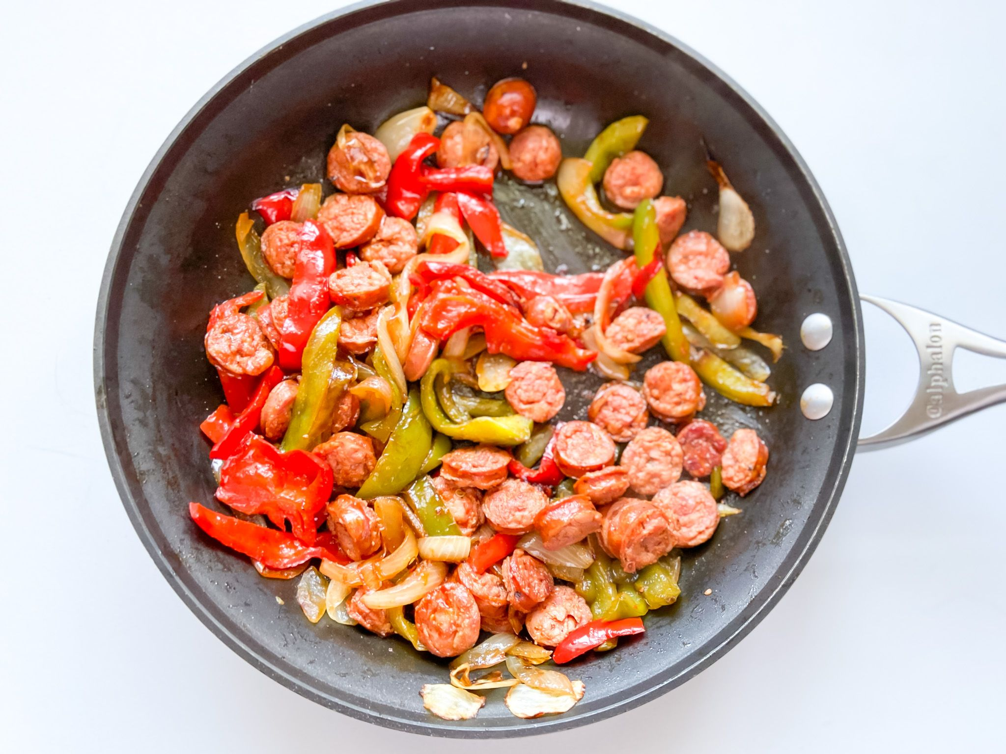 sausage and peppers in skillet